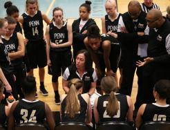 Penn Coach Kristi Ulrich with the Penn Girls Basketball team