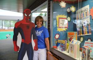 Mrs. Knapp showing off the Super Hero reading program