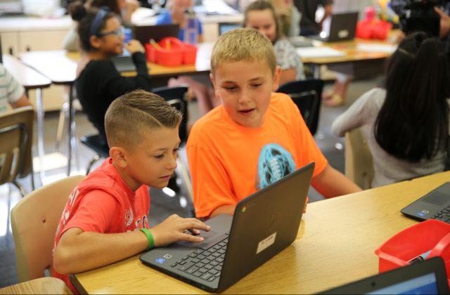 Elm Road students on Chromebooks