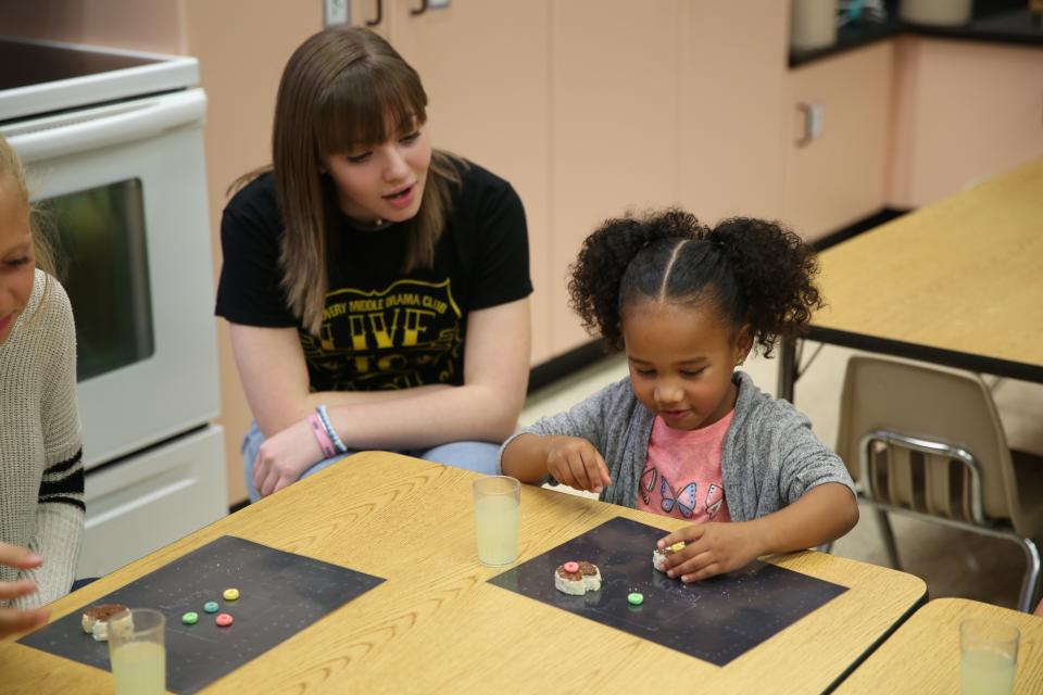 Penn student working with a child during Penn Playschool (2018)