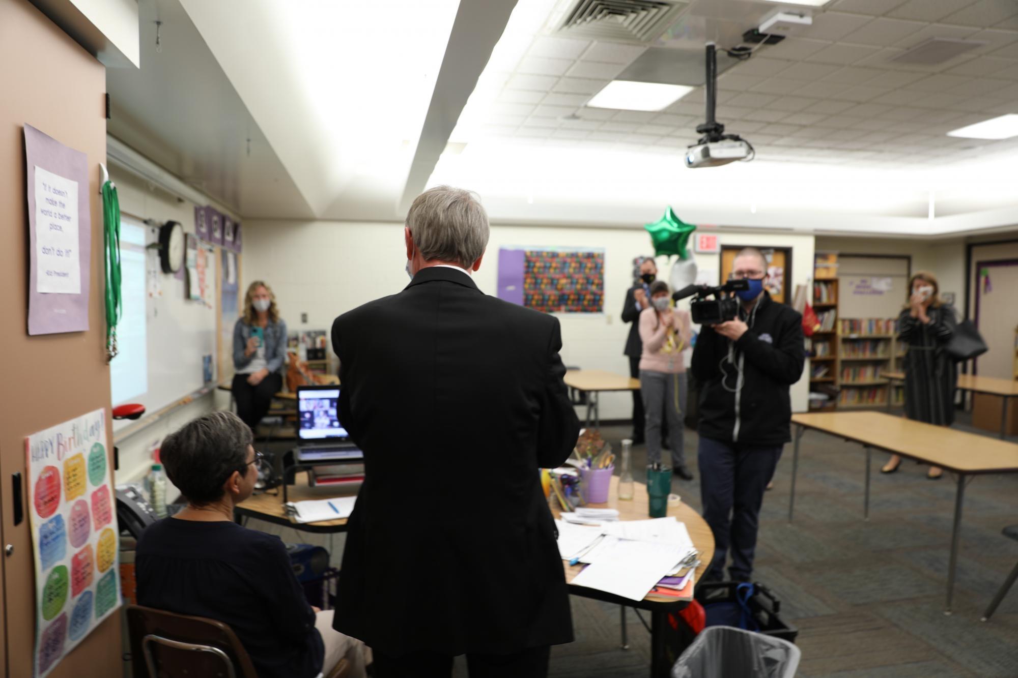 Dr. Thacker surprises Mrs. Shreiner while she's teaching her virtual class