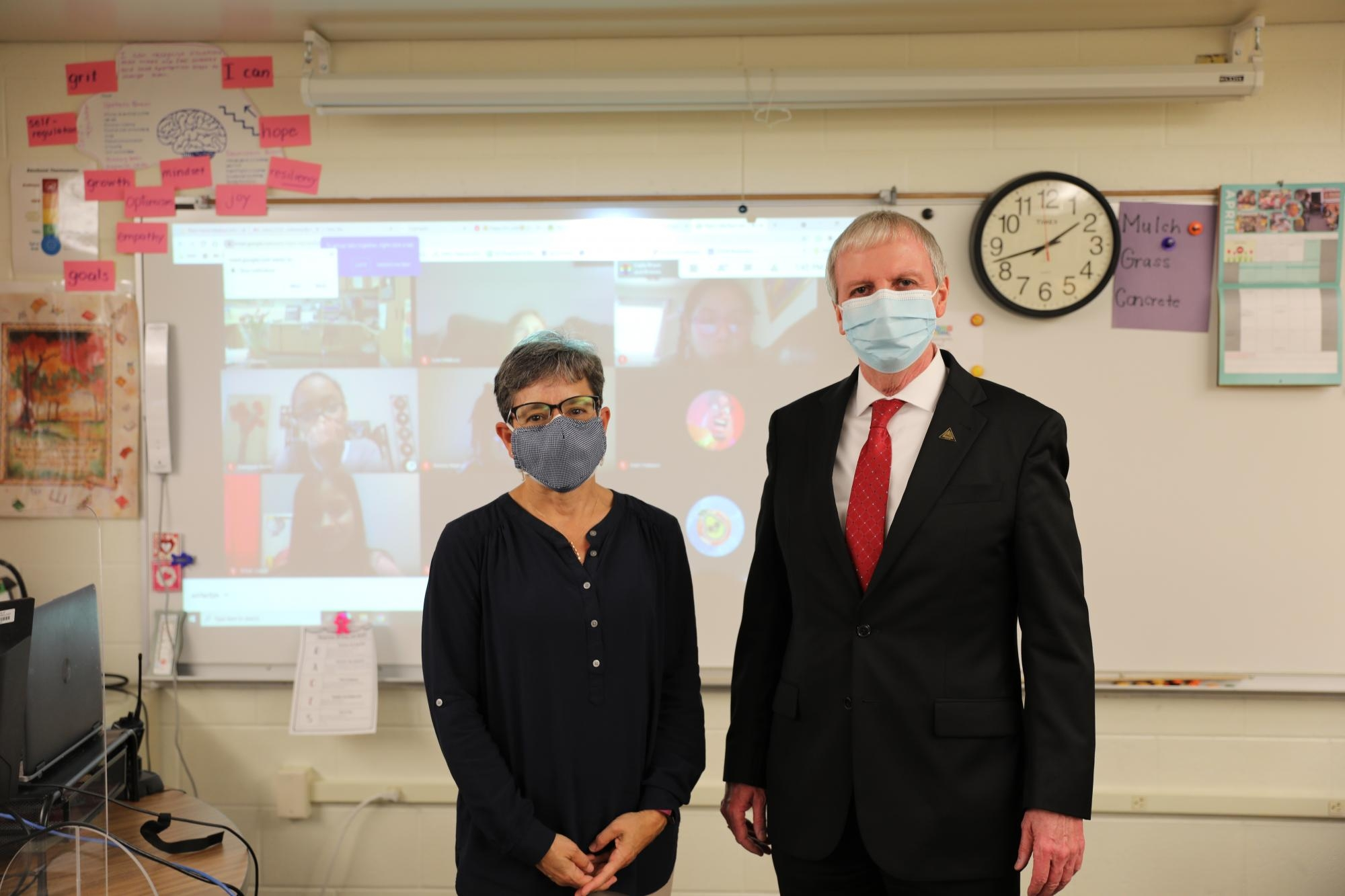 PHM Supt. Dr. Thacker with newly named 2021 PHM Elementary Teacher of the Year Mrs. Kathy Shreiner with her virtual students in the background